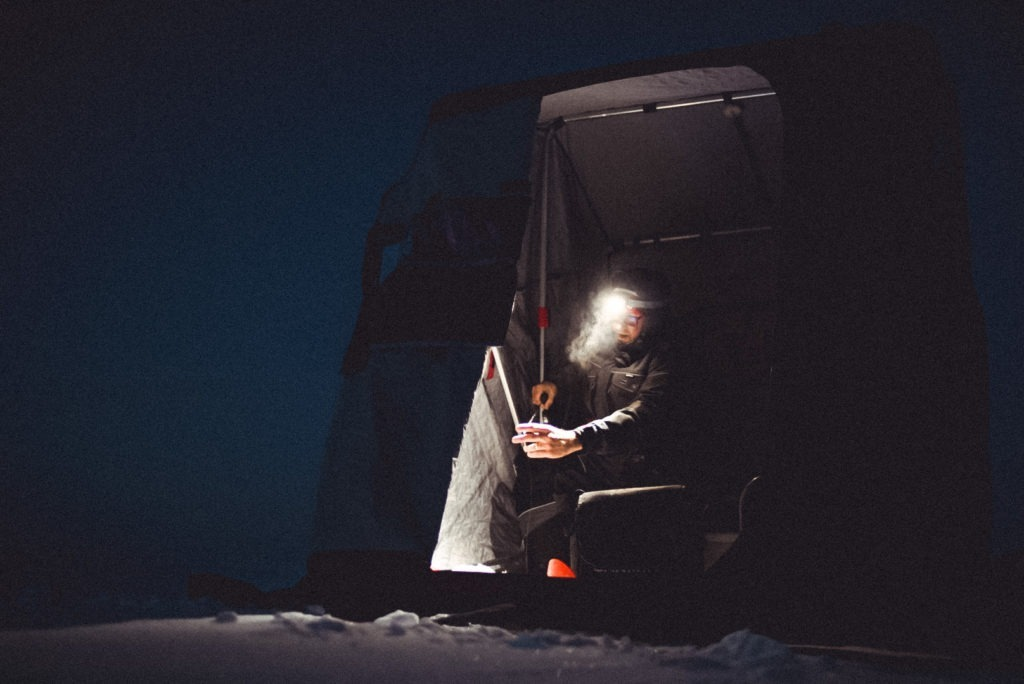 Ice fishing after dark on Lake Manitoba
